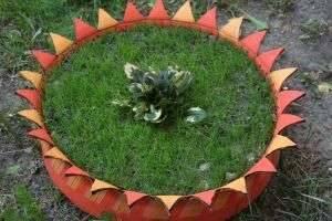 Как сделать клумбу из покрышки: креативное и необычное оформление сада
